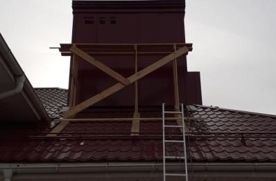 Ремонт примыкания основания трубы, отделка фасада трубы